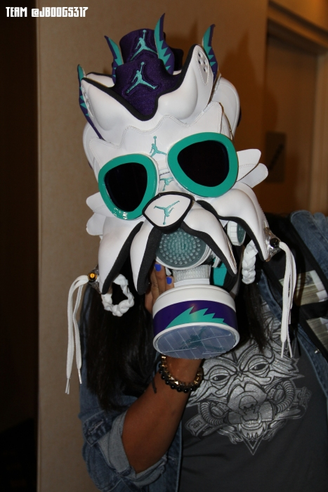 Jenny (@jboogs317) holding the Grape V mask with the PROFITink Wolf tee