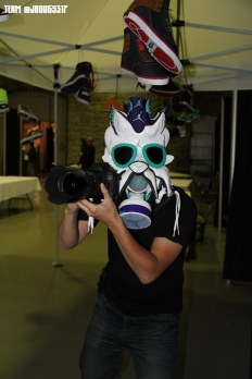 Ivan snapping pics while wearing the Grape V mask