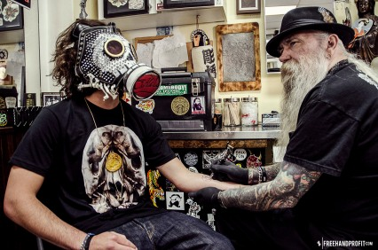 The legendary Rick Walters tattooing Jackson Rogow (masked)
