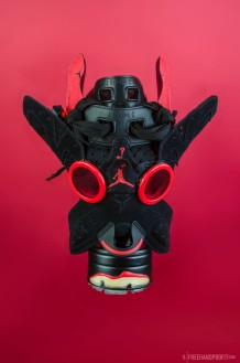 "The 47th sneaker mask created by Freehand Profit. Made from 1 pair of Retro Jordan VI (6s) ""Black Infrared from the 2010 Infrared Pack. Find out more about the work on FREEHANDPROFIT.com."
