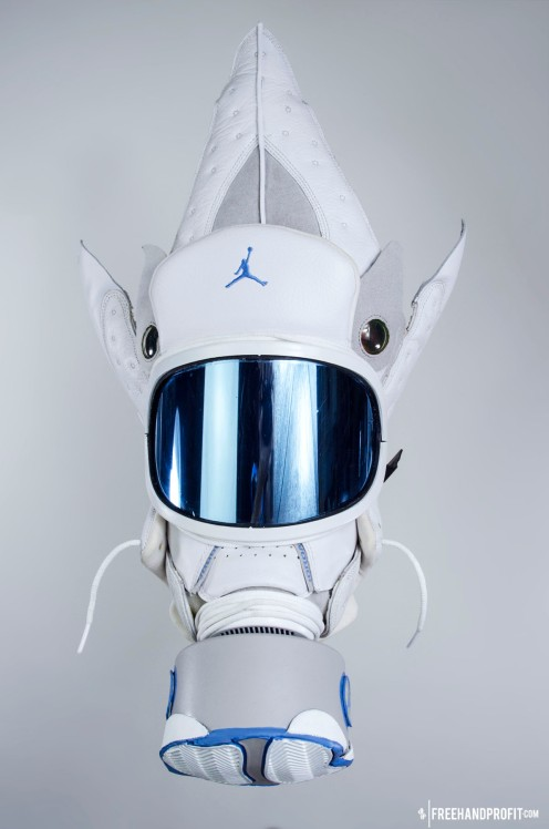 The 62nd sneaker mask created by Freehand Profit. Made from 1 pairs of Air Jordan XIII (13) Neutral Grey / University Blue from 2005. This mask from 2013 was commissioned by Reggie Williams, star guard of the Houston Rockets. Find out more about the work on FREEHANDPROFIT.com.