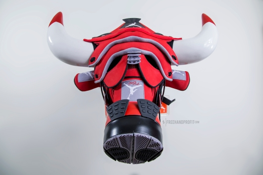 "The ""Toro IV"" mask is the 70th sneaker mask created by Freehand Profit. Commissioned by K. Santa. Made from 2 pair of Air Jordan 4s ""Toro"". Find out more about the work on FREEHANDPROFIT.com."