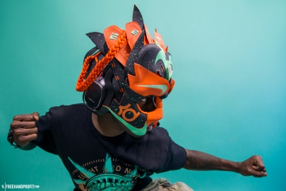 """The 75th sneaker mask created by Freehand Profit. Made from 3 pairs of KD 6 """"Texas"""" and a wireless gaming headset by ASTRO Gaming. Find out more about the work on FREEHANDPROFIT.com."""