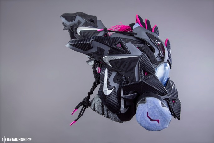 "The 89th sneaker mask created by Freehand Profit. Made from 2 pairs of Nike LeBron 11 ""Miami Nights"". The 89th mask pays homage to Freehand Profit's tie to Miami street wear brand 8&9 (8and9.com). Modeled by @PEISOBG of @8and9 Find out more about the work on FREEHANDPROFIT.com."