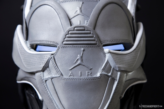 The 117th sneaker mask created by Freehand Profit and his first time collaborating with Mache Customs. Made from 4 pairs of Air Jordan 5Lab3 sneakers. Features functioning face plate, lights and lasers. Find out more about the work on FREEHANDPROFIT.com.